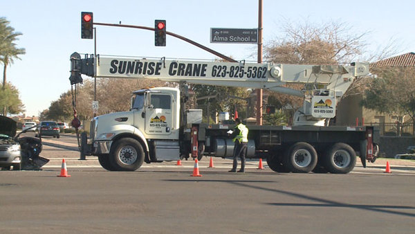 2 injured when crane truck hits car in chandler az for Department of motor vehicles chandler arizona