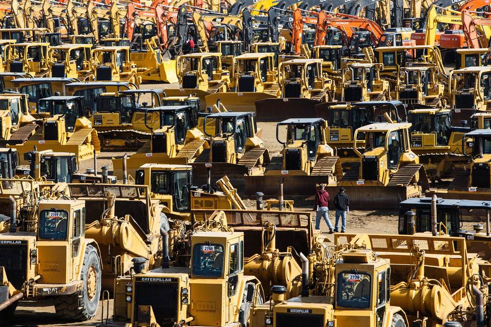 A Ritchie Bros. auction in Nisku, Alberta, on April 26. Trends toward leases and rentals are creating larger fleets of used equipment that trickle down the value chain. Machinery gluts can be lengthy because such equipment can last a quarter of a century or longer.