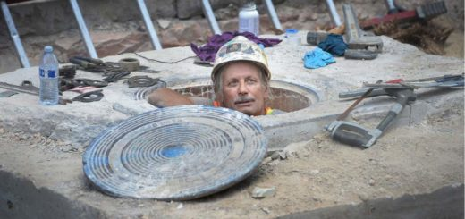 A worker pops up out of a manhole cover in Salt Lake City, Utah. There is currently a shortage of construction workers.